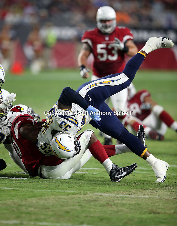 San Diego Chargers inside linebacker Kavell Conner (53) gets upended on a hard tackle on Arizona Cardinals running back David Johnson (31) during the 2015 NFL preseason football game against the Arizona Cardinals on Saturday, Aug. 22, 2015 in Glendale, Ariz. The Chargers won the game 22-19. (©Paul Anthony Spinelli)