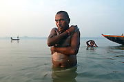 Faggu Ram, a Dalit Weaver, comes to bathe at the Varuna Sangam every morning before going to the temple to pray. Nowadays, because scientists have found so much pollution in the Ganga, people who bathe regularly its waters are at risk of infection. These images were made as part of a personal project on the handloom weavers in Varanasi. In these, I looked at the access to health and infrastructure that weaver's have. I am grateful to the help I received from the People's Vigilance Committee on Human Rights (PVCHR).