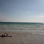 A tourist relaxes in the pristine waters at White Beach on September 29, 2008 in Boracay Island, the Philippines. Photo Tim Clayton..Asian tourists at White Beach, Boracay Island, the Philippines...The 4 km stretch of White beach on Boracay Island, the Philippines has been honoured as the best leisure destination in Asia beating popular destinations such as Bali in Indonesia and Sanya in China in a recent survey conducted by an International Travel Magazine with 2.2 million viewers taking part in the online poll...Last year, close to 600,000 visitors visited Boracay with South Korea providing 128,909 visitors followed by Japan, 35,294, USA, 13,362 and China 12,720...A popular destination for South Korean divers and honeymooners, Boracay is now attracting crowds of tourists from mainland China who are arriving in ever increasing numbers. In Asia, China has already overtaken Japan to become the largest source of outland travelers...Boracay's main attraction is 4 km of pristine powder fine white sand and the crystal clear azure water making it a popular destination for Scuba diving with nearly 20 dive centers along White beach. The stretch of shady palm trees separate the beach from the line of hotels, restaurants, bars and cafes. It's pulsating nightlife with the friendly locals make it increasingly popular with the asian tourists...The Boracay sailing boats provide endless tourist entertainment, particularly during the amazing sunsets when the silhouetted sails provide picture postcard scenes along the shoreline...Boracay Island is situated an hours flight from Manila and it's close proximity to South Korea, China, Taiwan and Japan means it is a growing destination for Asian tourists... By 2010, the island of Boracay expects to have 1,000,000 visitors.