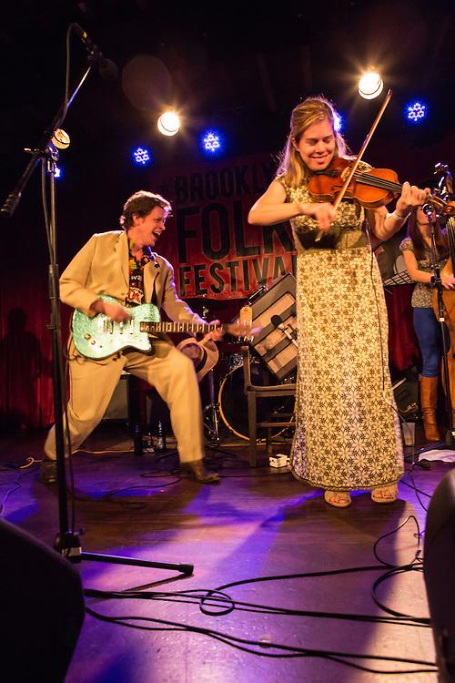 Kari Denis, on fiddle, accompanies Alex Battles.