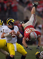 John Kerr, right, of Ohio State forces an incomplete pass.