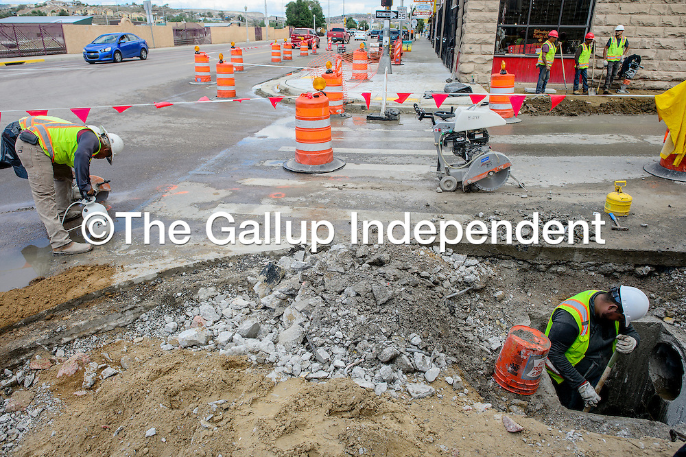 A crew from Century Club Construction works on renovations to the crosswalk at Historic Route 66 and Third Street in downtown Gallup Tuesday. Crosswalks along Route 66 from Third Street east to Strong Avenue are being updated to meet the Americans with Disabilities Act standards.