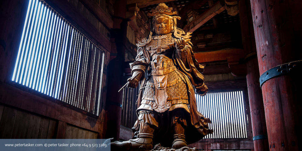 Komokuten, one of a pair of guardians, beside Buddha, Diabutsu, inside Todaiji Temple, Nara, Japan.