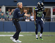 Aug 25, 2017; Seattle, WA, USA; Seattle Seahawks coach Pete Carroll (left) and cornerback Richard Sherman (25) react during a NFL football game against the Kansas City Chiefs at CenturyLink Field. The Seahawks defeated the Chiefs 26-13.