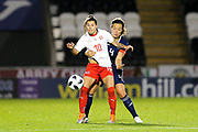 Ramona Bachmann (#10) of Switzerland and Rachel Corsie (#4) of Scotland battle for the ball during the 2019 FIFA Women's World Cup UEFA Qualifier match between Scotland Women and Switzerland at the Simple Digital Arena, St Mirren, Scotland on 30 August 2018.