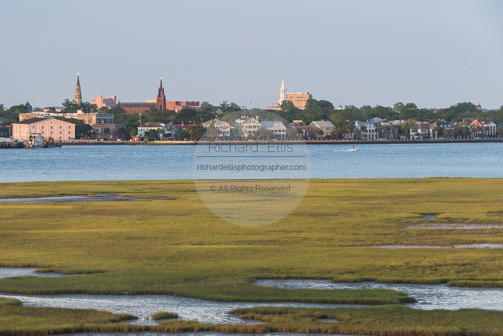 Saltwater marsh view and city skyline along the Ashley River at sunset in Charleston, South Carolina.