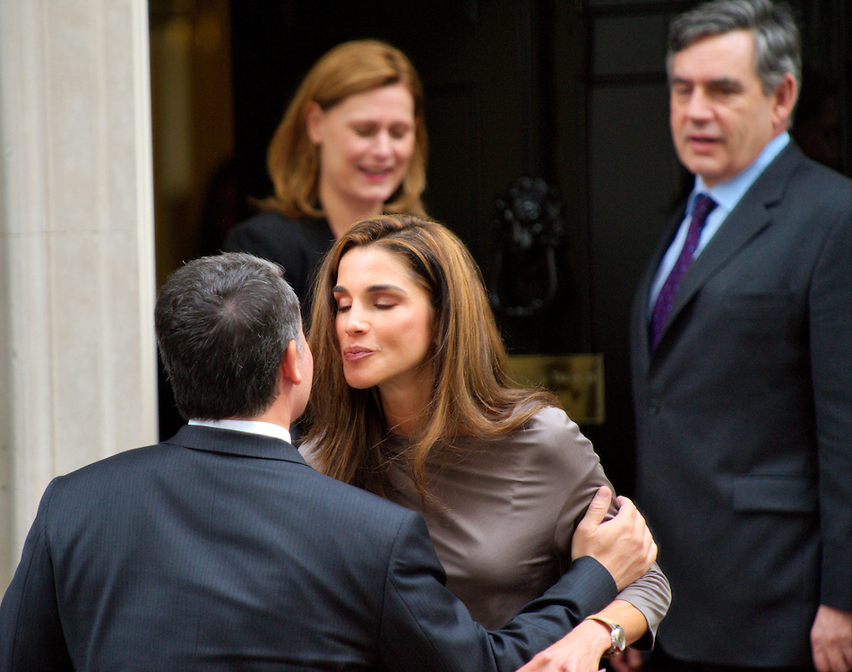 LONDON, ENGLAND - JUNE 22:  King Abdullah II of Jordan kiss wife Queen Rania   while leaving for separate engagements after an  an official visit  at Downing Street on June 22, 2009 in London, England.  (Photo by Marco Secchi/Getty Images)