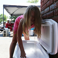 Elizabeth McKissick, 8, puts ice in a cup for a customer at the Alex's Lemonade Stand to raise money for St. Jude Children's Research Hospital Saturday