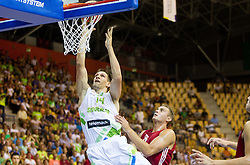 Gasper Vidmar of Slovenia faulted by Rolands Freimanis of Latvia during friendly match between National teams of Slovenia and Latvia for Eurobasket 2013 on August 2, 2013 in Arena Zlatorog, Celje, Slovenia. (Photo by Vid Ponikvar / Sportida.com)