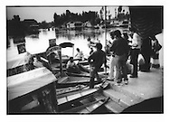 "Hindu tourists negotiate with Muslim Kashmiri ""shakara"" boatmen for rides upon Dal Lake, Srinagar, Indian Administered Kashmir.  Tourism is Kashmir's primary source of income.  Tourist industry numbers, particularly the number of foreign tourists,  have been a mere fraction of what they had been before the current trouble beginning in the 1990's."