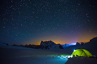 An impression of a basecamp at Col du Midi on a cold Summer night. In the background the silhouettes of Deant du Geant and Grand Jorasses.