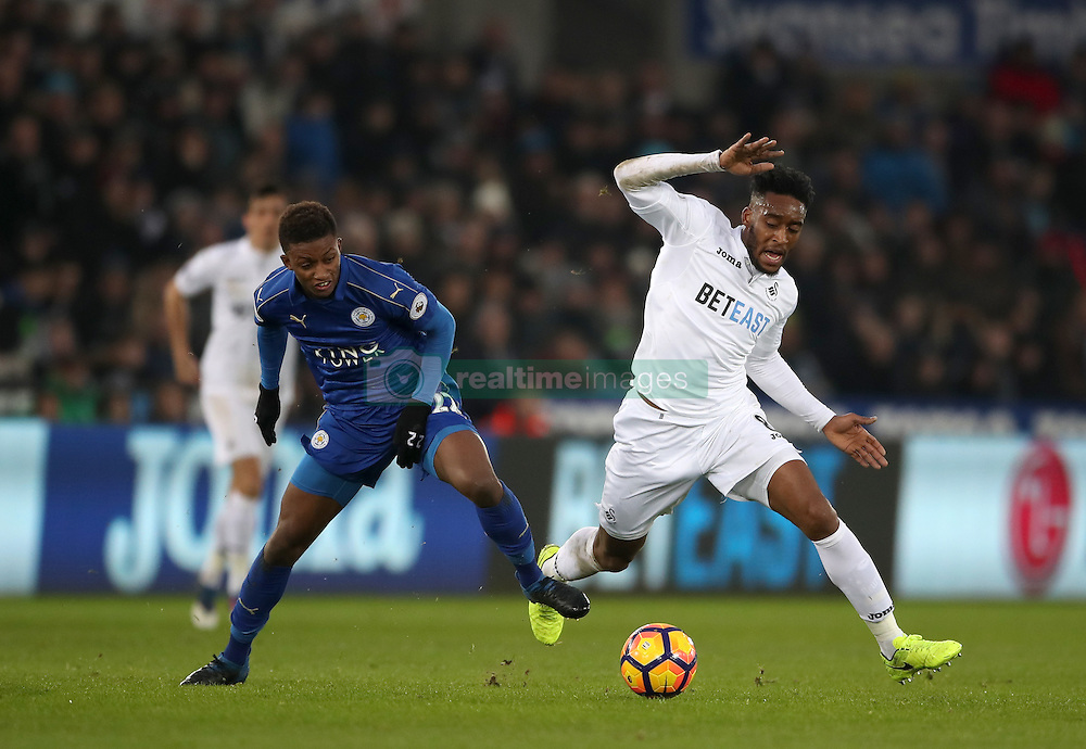 Leicester City's Demarai Gray (left) and Swansea City's Leroy Fer during the Premier League match at the Liberty Stadium, Swansea.