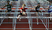 05/14/2009 - Lincoln's Megan Macoubray (515) eyes the finish line while clearing the last barrier during the women's 100 meter hurdles.  The 6A PIL Varsity District Track Meet takes place at Lewis and Clark College....KEYWORDS:  City, Portland, sports, high school, state, boys, girls