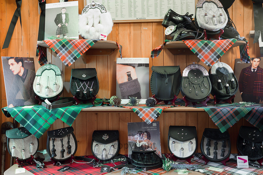 Sporrans and traditional highland clan tartan on display for sale at Lochcarron Weavers in Lochcarron in the Highlands of Scotland