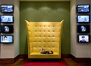 A young boy enjoys the comfort of a high-backed sofa in the lobby of the IP Boutique Hotel in the Itaewon district of of Seoul, South Korea on 25 June 2010..Photographer: Rob Gilhooly