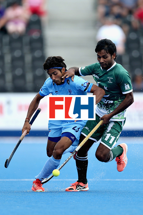 LONDON, ENGLAND - JUNE 18: Pardeep Mor of India tangles with Ajaz Ahmad of Pakistan during the Hero Hockey World League Semi Final match between Pakistan and India at Lee Valley Hockey and Tennis Centre on June 18, 2017 in London, England.  (Photo by Alex Morton/Getty Images)