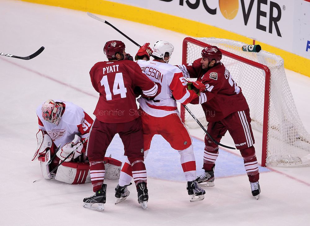 Feb. 6 2012; Glendale, AZ, USA; Phoenix Coyotes forward Kyle Chipchura  (24) and teammate forward Taylor Pyatt (14) battle with Detroit Red Wings defensemen Jonathan Ericsson (52) and goalie Joey MacDonald (31) makes a save during the third period at Jobing.com Arena. The Coyotes defeated the Red Wings 3-1. Mandatory Credit: Jennifer Stewart-US PRESSWIRE..Feb. 6 2012; Glendale, AZ, USA; Detroit Red Wings XXX reacts on the ice against the Phoenix Coyotes XXX during the third period at Jobing.com Arena. The Coyotes defeated the Red Wings 3-1.  Mandatory Credit: Jennifer Stewart-US PRESSWIRE.
