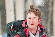 Portrait of Jeff Wanner smiling in a blizzard, Uncompahgre National Forest, Colorado.