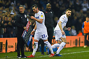 Stuart Dallas of Leeds United (15) comes on for Jack Harrison of Leeds United (22) as Darren Moore of West Bromwich Albion (Manager) looks on during the EFL Sky Bet Championship match between Leeds United and West Bromwich Albion at Elland Road, Leeds, England on 1 March 2019.