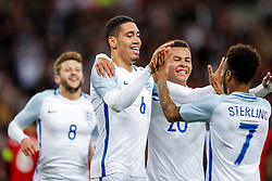 Chris Smalling of England celebrates with Dele Alli and Raheem Sterling after scoring a goal to make it 1-0 - Mandatory byline: Rogan Thomson/JMP - 02/06/2016 - FOOTBALL - Wembley Stadium - London, England - England v Portugal - International Friendly.