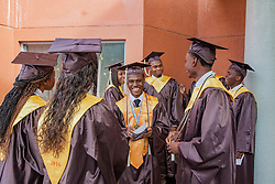 Valedictorian Kenique Liburd is surrounded by his classmates as they prepare to enter the commencement.  St. Thomas/St. John Seventh Day Adventist School Commencement Service.  Bertha C. Boschulte Auditorium.  St. Thomas, USVI.  12 June 2016.  © Aisha-Zakiya Boyd