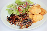 grilled chicken escalope with french fries and salad