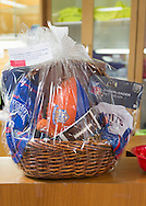 Wantagh, New York, USA. February 5, 2017.  A gift basket filled with Kitten Bowl and NY orange and blue football game themed presents is a raffle prize at Last Hope Animal Rescue's Open House party during Hallmark Channel's Kitten Bowl IV. Kittens in Last Hope Lions team played against kittens in North Shore Bengals team. Last Hope kittens have been part of each Kitten Bowl, whose purpose is to promote cat and kitten adoptions.