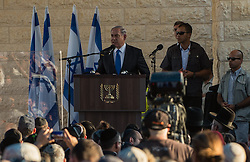 Israeli Prime Minister Benjamin Netanyahu addresses a joint funeral for the three Israeli teens at a cemetery in Modi'in near Jerusalem, on July 1, 2014. The three Israeli teens whose bodies were found Monday evening were brought to rest side by side on Tuesday at a joint funeral held in Modi'in near Jerusalem. Tens of thousands of people participated in the funeral, including Prime Minister Benjamin Netanyahu and President Shimon Peres, who eulogized the three, whose caskets were wrapped with Israeli flags. EXPA Pictures © 2014, PhotoCredit: EXPA/ Photoshot/ Li Rui<br /> <br /> *****ATTENTION - for AUT, SLO, CRO, SRB, BIH, MAZ only*****