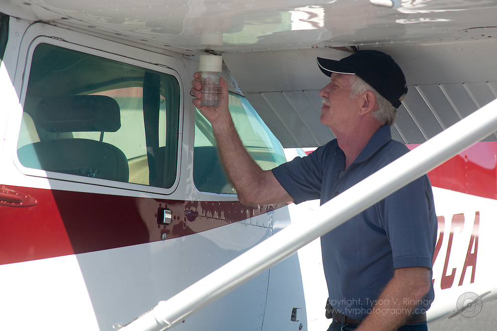 EAA Co-Chairman, Chesley 'Sully' Sullenberger pre-flights a Cessna 172 to check for flying conditions prior to the day's Young Eagle flights.