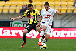 The Phoenix's Ali Abbas, left and Adelaide United's Karim Matmour contest the ball in the A-League football match at Westpac Stadium, Wellington, New Zealand, Sunday, October 08, 2017. Credit:SNPA / Dean Pemberton **NO ARCHIVING**