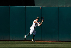 OAKLAND, CA - MAY 01: Billy Burns #1 of the Oakland Athletics catches a fly ball hit off the bat of Tyler White (not pictured) of the Houston Astros during the ninth inning at the Oakland Coliseum on May 1, 2016 in Oakland, California. The Houston Astros defeated the Oakland Athletics 2-1. (Photo by Jason O. Watson/Getty Images) *** Local Caption *** Billy Burns
