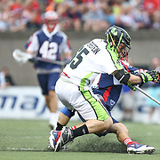 Mike Unterstein #65 of the New York Lizards falls on top of Mike Stone #41 of the Boston Cannons during the game at Harvard Stadium on July 19, 2014 in Boston, Massachusetts. (Photo by Elan Kawesch)