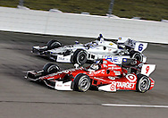 Scott Dixon (9) and Katherine Legge (6) race side by side during the IZOD IndyCar Iowa Corn Indy 250 auto race at the Iowa Speedway in Newton, Iowa on Saturday, June 23, 2012.