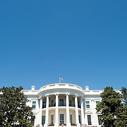 Close shot of the South Portico of the White House in Washington DC. This side of the building is the better known side and faces the Washington Monument and Jefferson Memorial. This shot is taken from close under portico on the South Lawn.