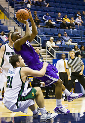 December 29, 2009; Berkeley, CA, USA;  Furman Paladins forward Amu Saaka (31) is fouled by Utah Valley Wolverines forward Jourdain Scoubes (21) during the second half at the Haas Pavilion.  Furman defeated Utah Valley 77-69.