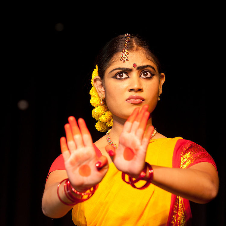 Classical Indian dancer in the style Bharata Natyam with expressive facial expression and hands up indicating no.