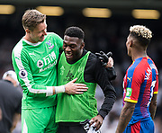 Wayne Hennessey (13) of Crystal Palace, Fulham (21) Timothy Fosu-Mensah, Patrick van Aanholt (3) of Crystal Palace during the Premier League match between Fulham and Crystal Palace at Craven Cottage, London, England on 11 August 2018.