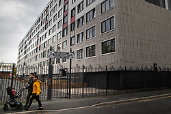 © Licensed to London News Pictures . 11/10/2018. Salford , UK . GV of Hornbeam Court on The Square with temporary cladding fitted on lower floors and unsafe cladding remaining in place above . Recently installed cladding at several council-owned tower blocks in Salford has been identified as having similar dangerous properties to that which was installed on the Grenfell Tower in London . Residents have been waiting months for clarification on what action will be taken to make their homes safe . Photo credit : Joel Goodman/LNP