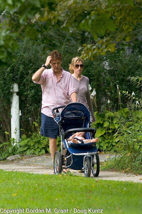 The Hamptons, NY - 091704 - Heather Mills and Paul McCartney walk with baby Beatrice shortly before leaving their vacation in The Hamptons...NO PHOTO CREDIT.ONE TIME USE. NO ELECTRONIC / INTERNET USE. ALL RIGHTS RESERVED...(Gordon M. Grant / Doug Kuntz Photo)..©2004 GORDON M. GRANT / DOUG KUNTZ.631-324-0858.GMGRANT@HAMPTONS.COM.WWW.GORDONMGRANT.COM..9 OAK LEDGE LANE.EAST HAMPTON, NY 11937.UNITED STATES