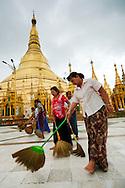 Women brooming Shwedagon pagoda's floor