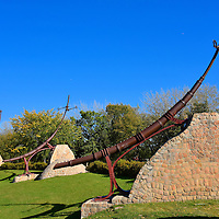"""Oodena Celebration Circle at The Forks in Winnipeg, Canada<br /> Over 6,000 years ago, Aboriginal groups lived along the rivers in Winnipeg.  This area was later occupied by several indigenous peoples including the Nakoda, Cree, Anishinaabe and Dakota.  To honor this heritage, a site was developed at The Forks in 1993 called Oodena Celebration Circle. In Ojibwa this means the """"heart of the city.""""  The park is shaped like a 200 foot bowl where archeologists found numerous artifacts dating back 3,000 years. Surrounding a large fire pit are eight steel structures called """"armatures"""" with sights that align to heavenly constellations."""