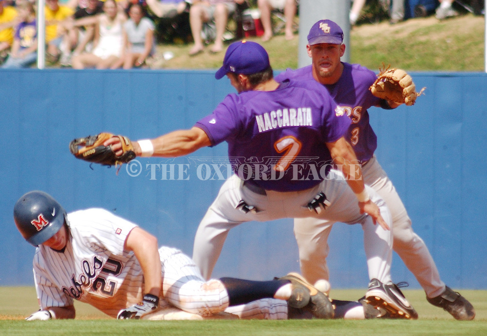Mississippi's Alex Presley (20) steals second as LSU second baseman Ivan Naccarata (7) falls down as shortstop Blake Gill backs up the play at Oxford-University Stadium in Oxford, Miss. Saturday, May 22, 2004. (AP Photo/Oxford Eagle, Bruce Newman)