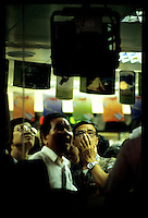 HONG KONG- OCT 28: People watch the monitors as the Heng Seng Index drops 13 percent to 8,776 the largest slide since 1989, amid the Asian financial crises.  (Photo by David Paul Morris)