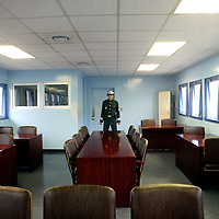 PANMUNJOM, MAY-16:  a South Korean soldier stands guard in the house that is shared by South and North Korea  in  the DMZ.