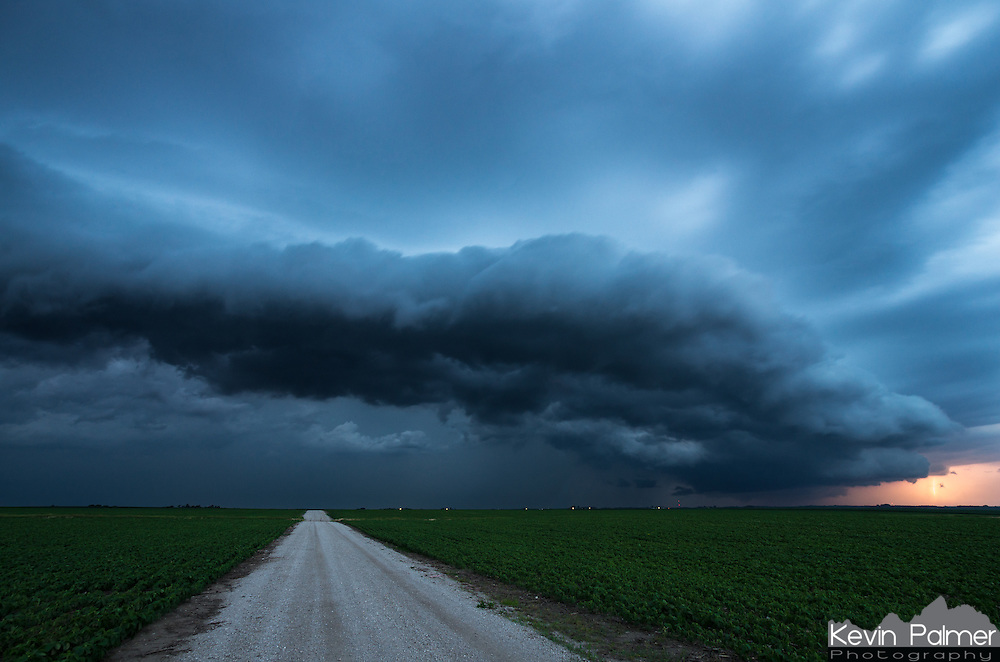 A shelf cloud approaches a field of soybeans near Delavan, IL. The late evening light made the clouds a cool blue while the lightning caused a warm glow.<br /> <br /> Date Taken: June 19, 2014