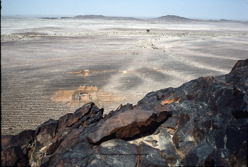 Igneous andesite in foreground was raw material for 300,000-year-old Dawadimi tool site on plain below. Saudi Arabia