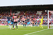 Sheffield Wednesday Forward Atdhe Nuhiu with a header at goal and goes wide during the Sky Bet Championship match between Brentford and Sheffield Wednesday at Griffin Park, London, England on 26 September 2015. Photo by Phil Duncan.