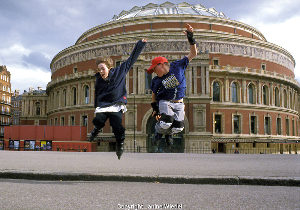 Ben and Max jumping on their inline skates in front of Albert Hall London.