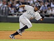 CHICAGO - JUNE 06:  Chone Figgins #9 of the Seattle Mariners gets caught in a rundown against the Chicago White Sox on June 6, 2011 at U.S. Cellular Field in Chicago, Illinois.  The White Sox defeated the Mariners 3-1.  The ball was ruled a hit.  (Photo by Ron Vesely)  Subject:  Chone Figgins