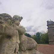 Mid afternoon rain rolling in at Chateau de Beloeil while the Centaur statue seems permanently adverse to having his photo taken